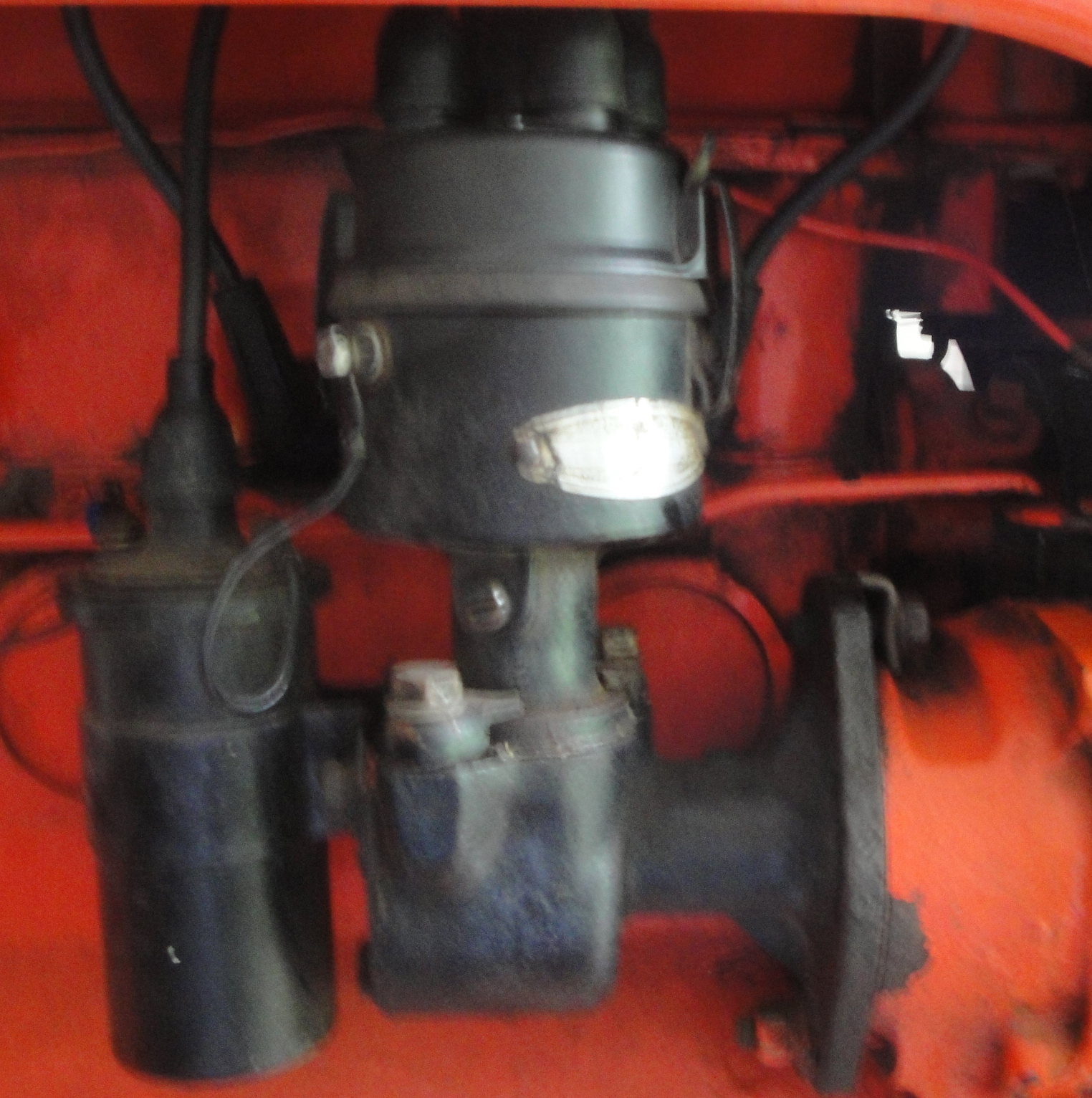 The plug wire on the right up front is the wire that goes to the #1  cylinder. It is in a different location from what ...